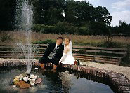 Bride and groom on the fountain of Steprath Mansion